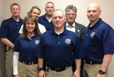 Left to right, front row: Officer Cindy Finch (Big Lake Police Dept.) Sgt. Kyle Wilson (Sherburne County Sheriff's Dept.) Sgt. Jason Lawson: (Becker Police Dept.).   Middle row: Deputy Michele Vlasak (Sherburne County Sheriff's Dept.) Mark Anderson (Barbara Schneider Foundation).  Back row: Detective Joe Gacke (Elk River Police Dept.) Sgt. Brian Boos (Elk River Police Dept.)